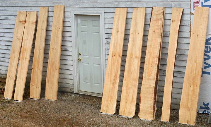 Wide pine boards milled with alaskain chainsaw mill