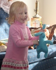 A Hand made stuffed animal toy makes little kids happy.