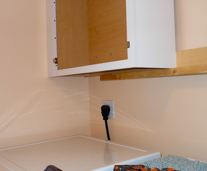 installing cabinets using a temporary support rail