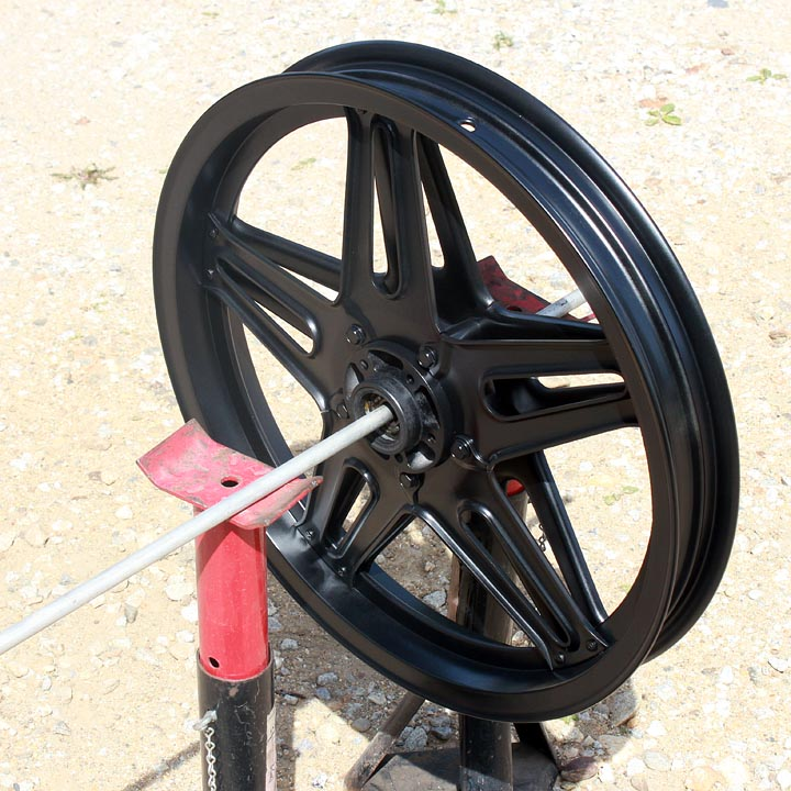 Painting a motorcycle wheel tips